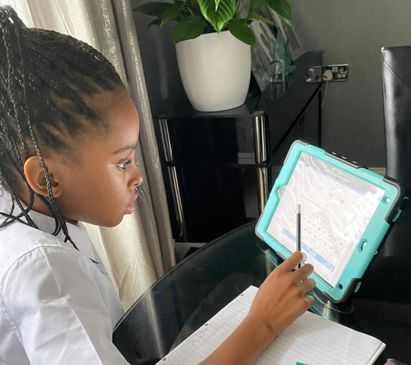 Girl using tablet as part of Aspire online tuition program