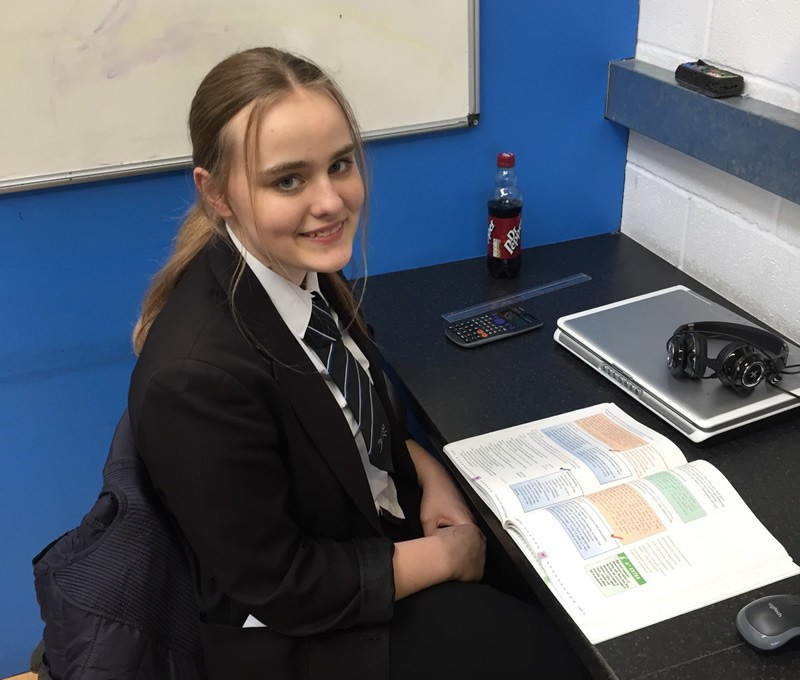 Girl with book, laptop, calculator and ruler