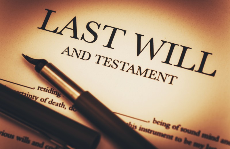 Last Will and Testament document overlaid with fountain pen