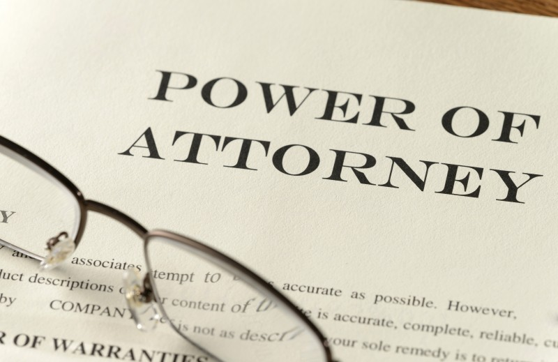 Power of attorney document and pair of glasses