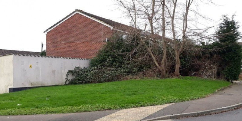 Pair of dwellings allowed on underused garage site and grassed area in Somerset