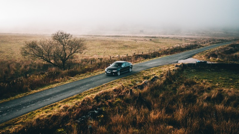 car driving through countryside